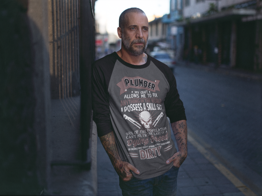middle-aged-man-with-a-beard-casually-leaning-against-a-wall-raglan-tee-mockup-a12611.png