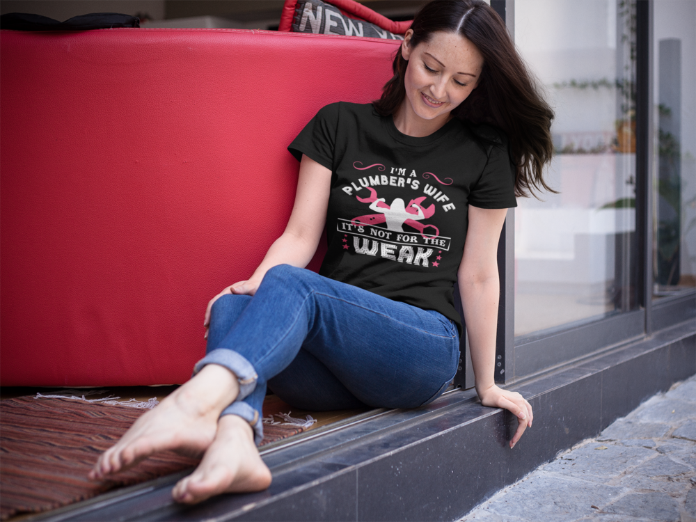 middle-aged-woman-without-shoes-sitting-down-while-wearing-a-tshirt-mockup-a15917.png
