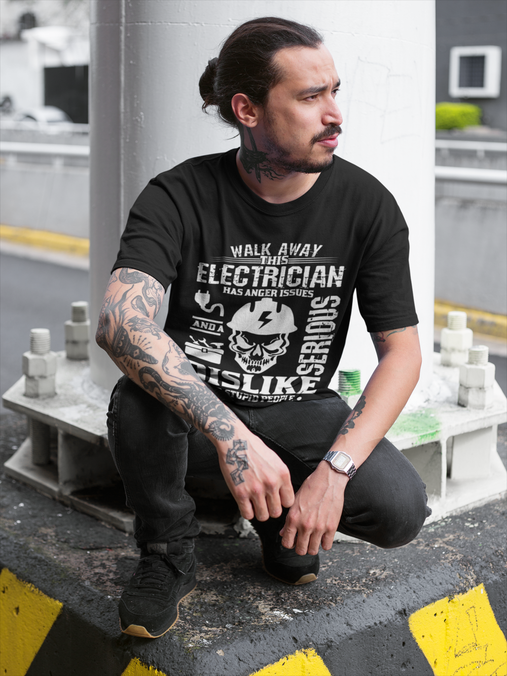 tattooed-man-wearing-a-round-neck-tee-mockup-while-crouching-under-a-bridge-a17078.png