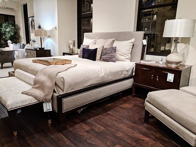 Happy Monday! Today we're highlighting one of our best-selling beds from @centuryfurniture designed by #thomasobrien We love the wood trim/nailhead combo - stop by the showroom to see this beauty in person!