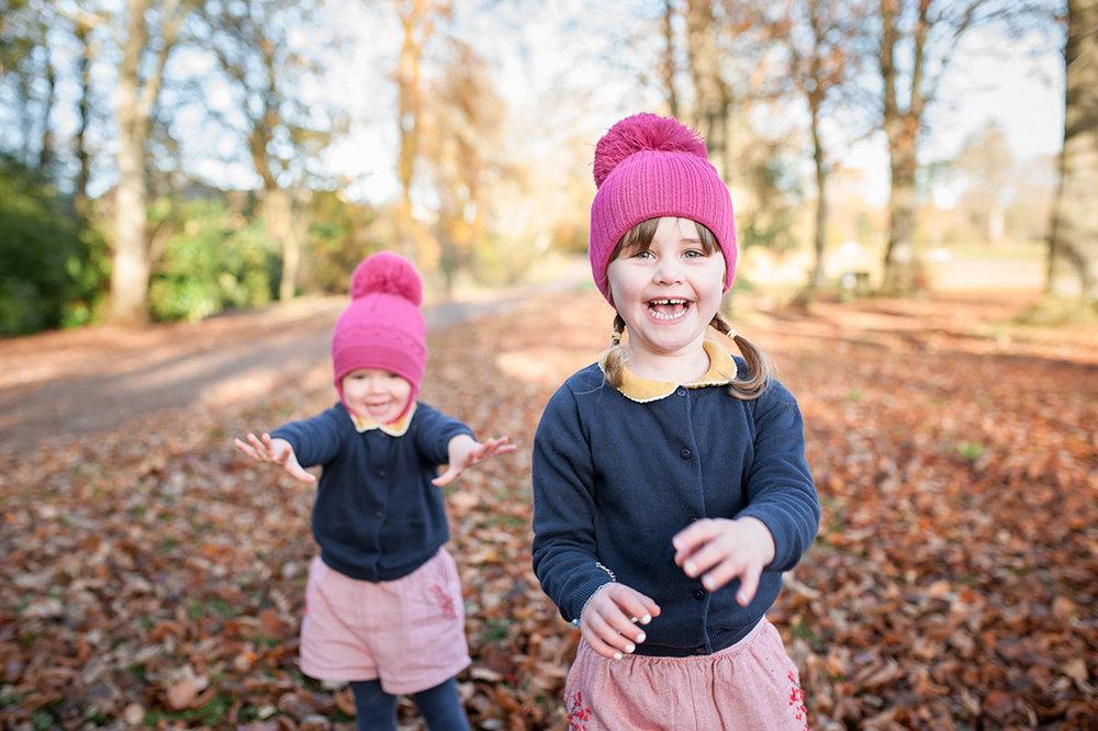 Sisters in Autumn throwing leaves (2).jpg