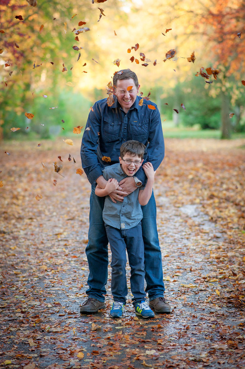 Father and son, leaf throw.