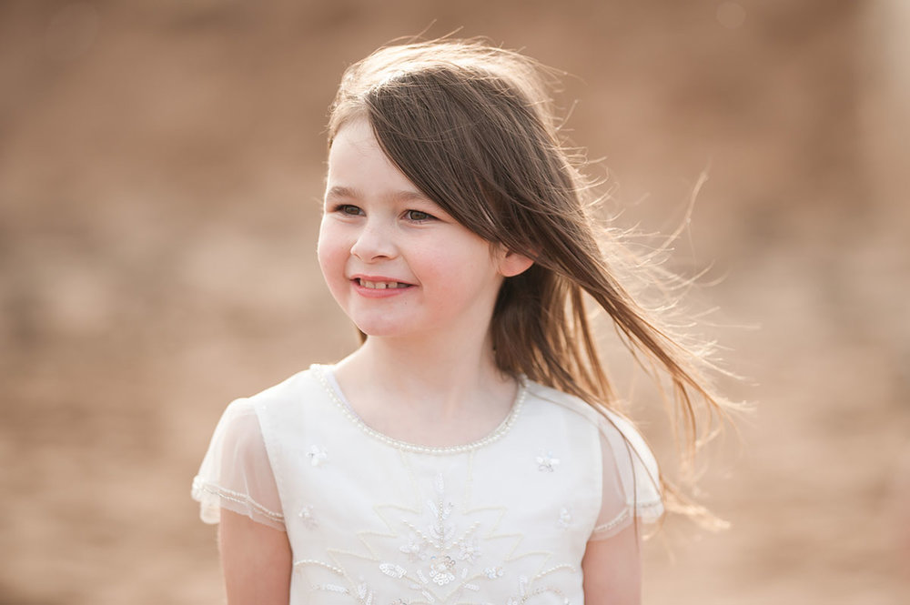 Little girl in golden sunset on Angus beach.jpg