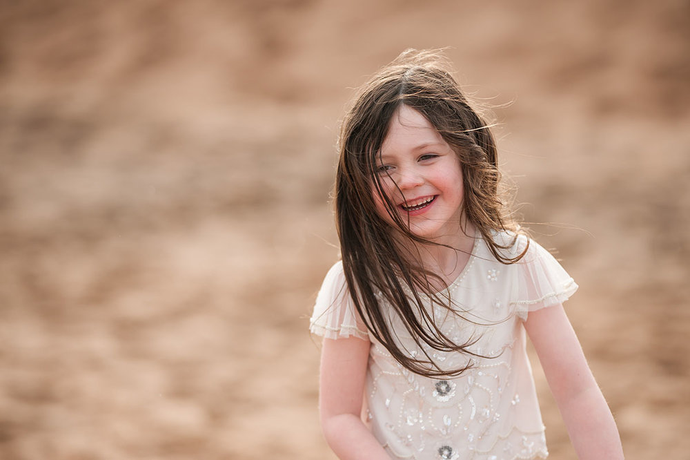 Little girl laughing on Angus beach.jpg