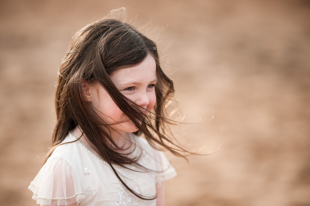 Little girl, hair blowing on Angus beach.jpg