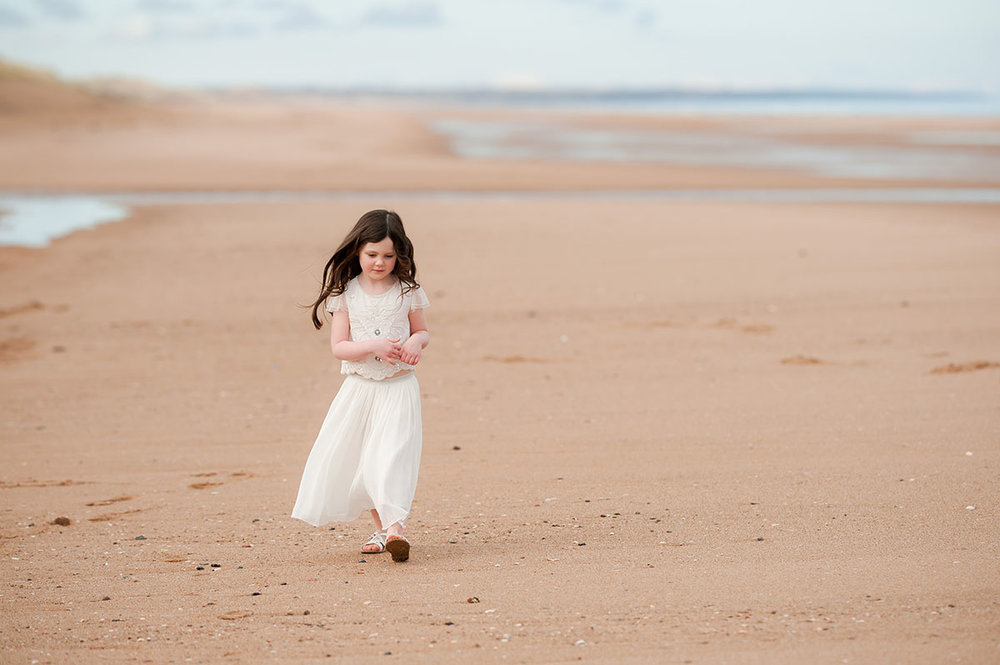 Little girl walking on Angus beach.jpg