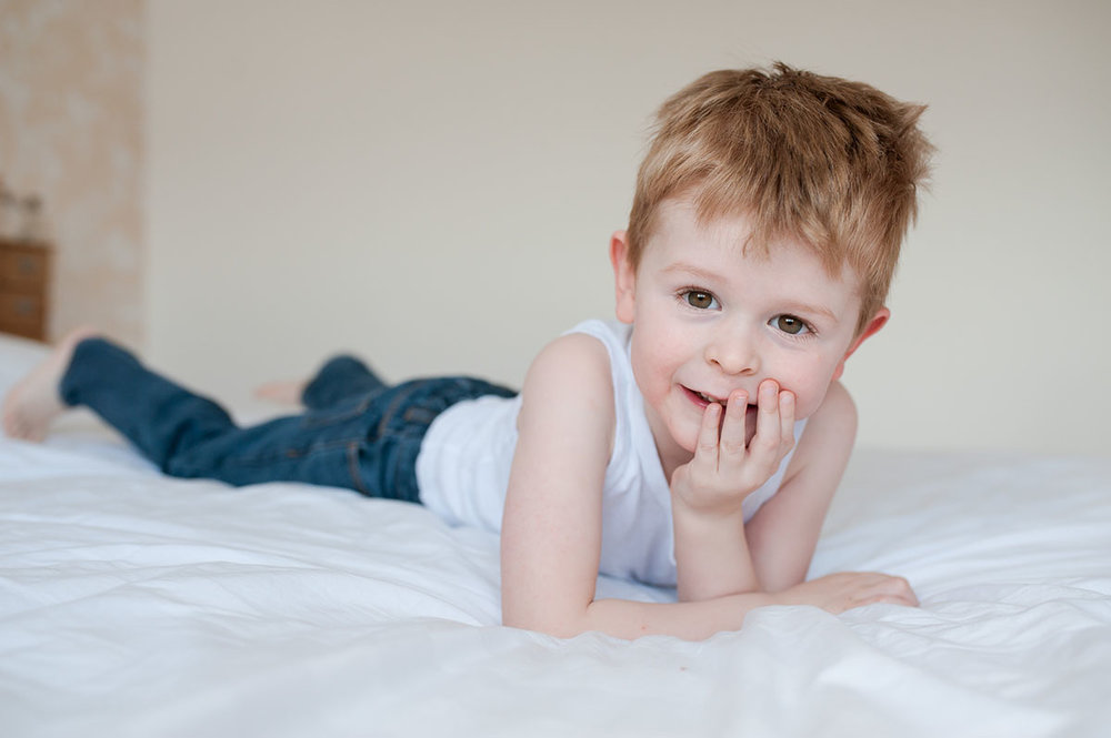 Little boy on bed in Dundee home