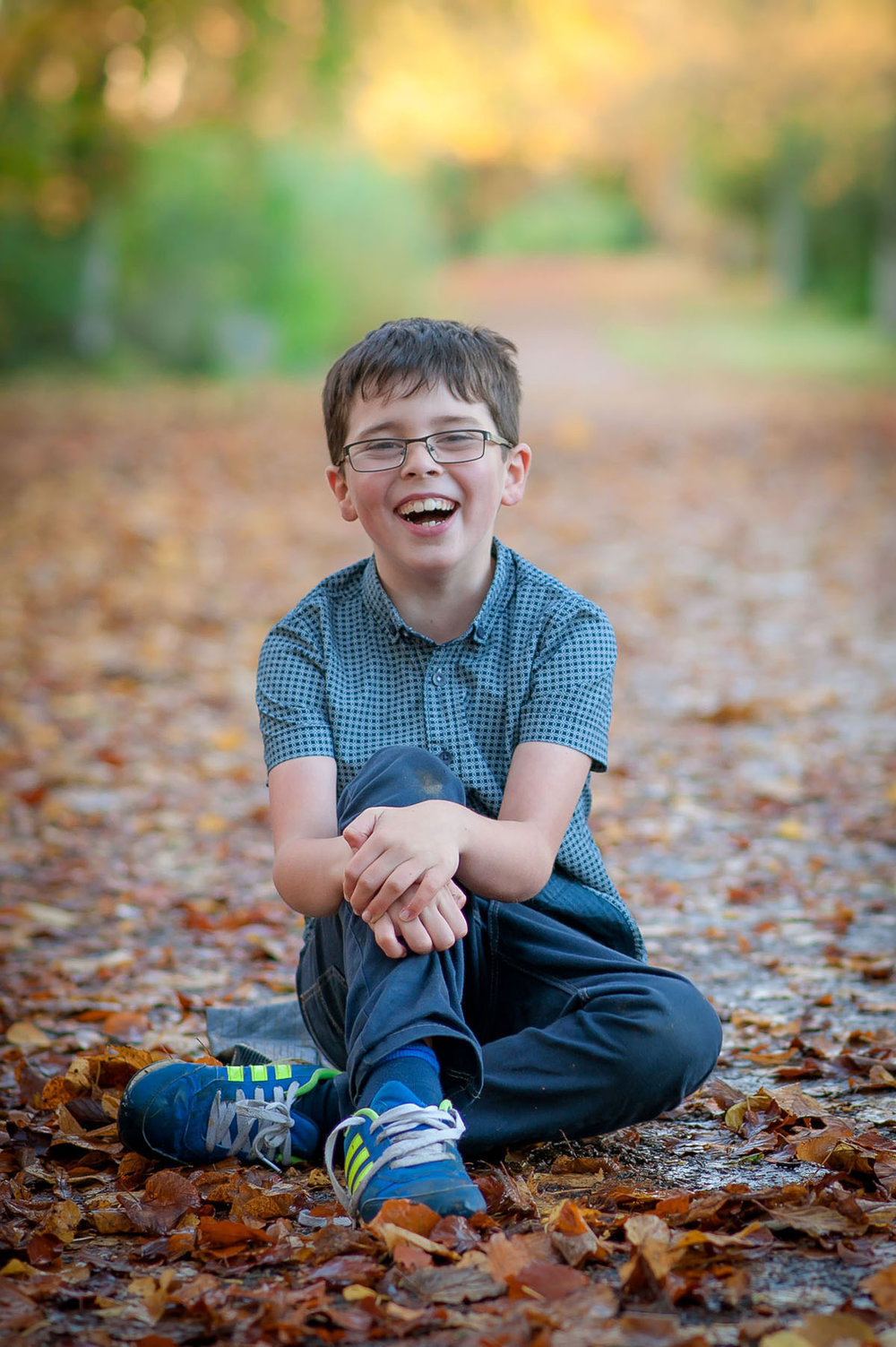 little boy giggling in Angus park.jpg