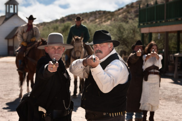 Brave men aim their guns in old west town