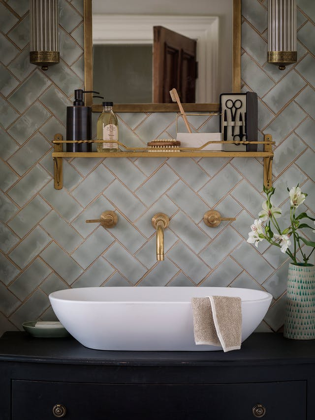 a subdued golden grout tone matching the fixtures #slays and elevates the what would traditionally be your average subway/herringbone configuration.