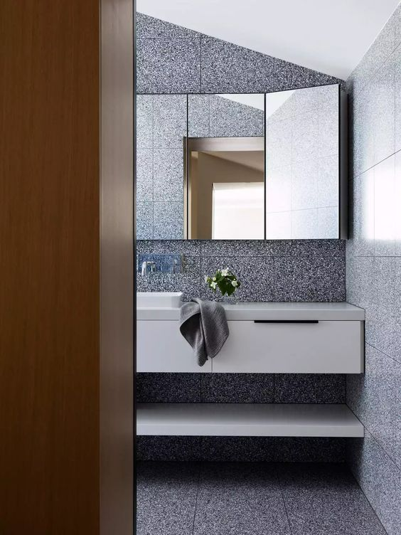 again, large format! a characteristic of terrazzo is the relative even distribution of the aggregate between tile to tile, so tiling rooms such as this appear as seamless as possible.