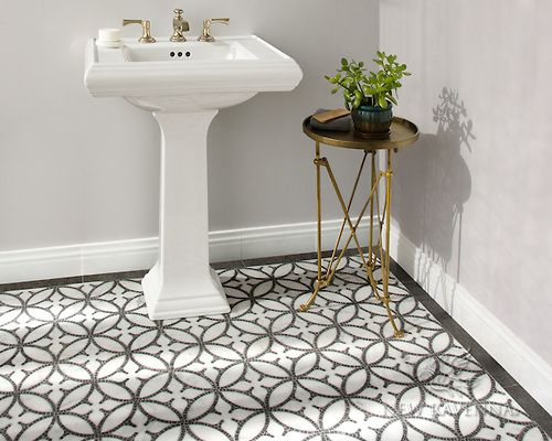 timeless is: a metal + stone + mosaic floor