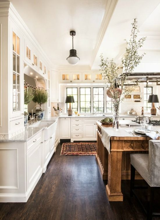 a modern tuscan kitchen; keep cabinets and countertops light, and stay (far) away from the use of scrolls and  excessive  decorative millwork.