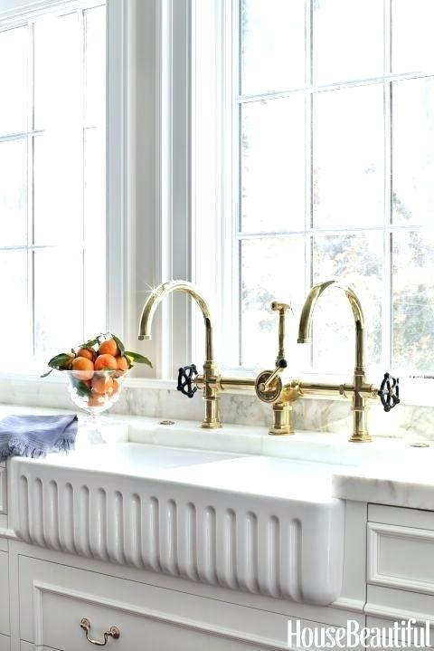 waterworks double industrial faucet in unlacquered brass - the ultimate guide to luxury plumbing by the delight of design