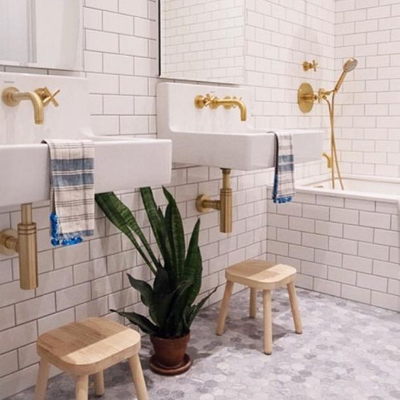 dornbracht bathroom with matte gold shower trim and wall mounted faucets with cross handles - the ultimate guide to luxury plumbing by the delight of design