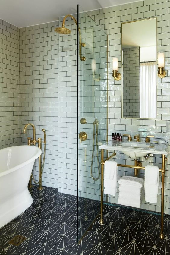 waterworks bathroom with shower and console in unlacquered brass - the ultimate guide to luxury plumbing by the delight of design