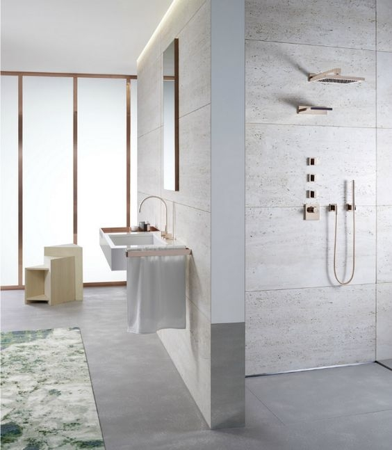 dornbracht bathroom featuring rose gold shower trim and lav - the ultimate guide to luxury plumbing by the delight of design