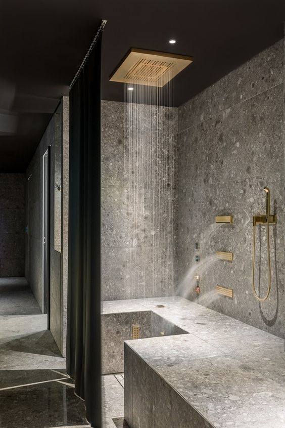 dornbracht contemporary shower in gold with rain ceiling panel and body sprays - the ultimate guide to luxury plumbing by the delight of design