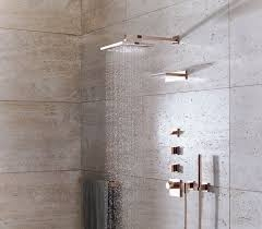 dornbracht contemporary square shower trim with rainhead and handshower in rose gold - the ultimate guide to luxury plumbing by the delight of design