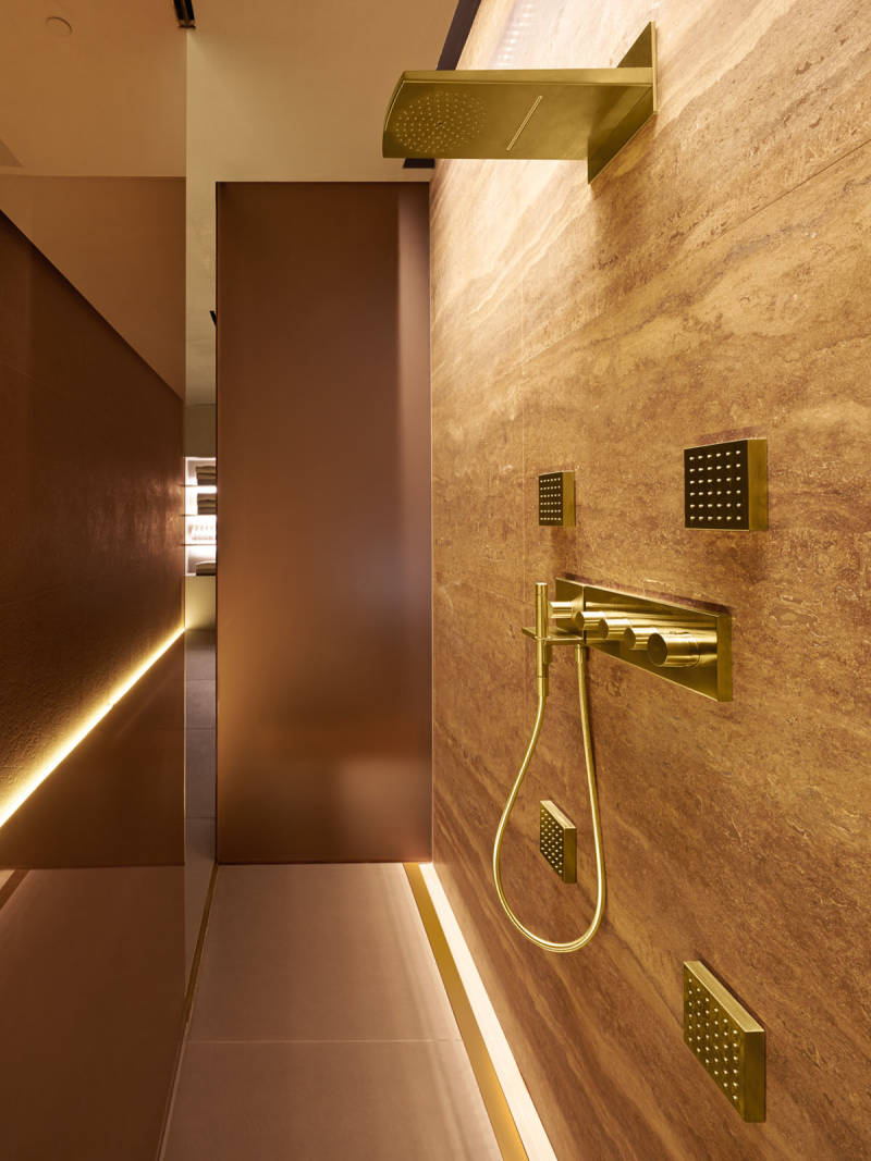 axor contemporary shower trim with rainhead in polished gold with bodysprays and handshower - the ultimate guide to luxury plumbing by the delight of design