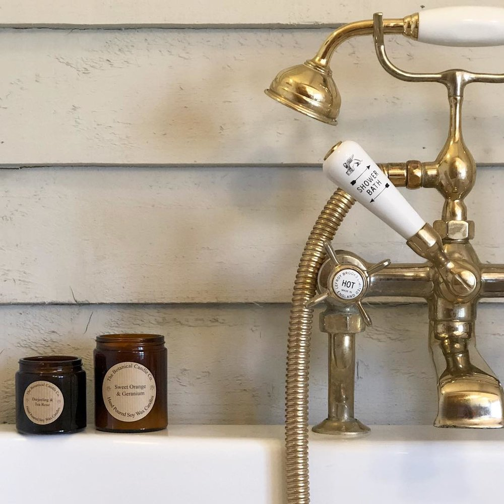 lefroy brooks traditional deck mounted tub filler and handshower with porcelain lever handles in unlacquered brass - the ultimate guide to luxury plumbing by the delight of design