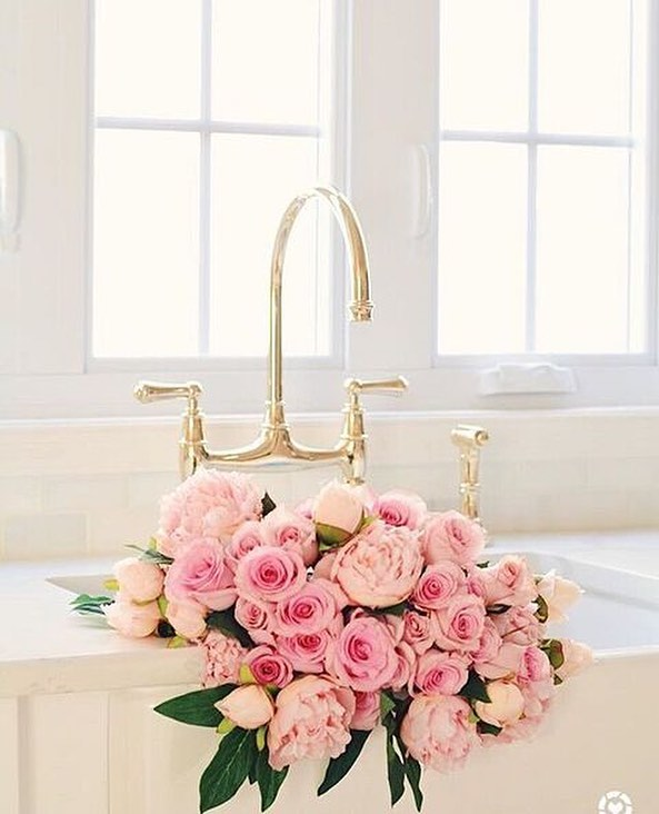 rohl traditional two hole bridge faucet with gooseneck and lever handles with sidespray in light polished gold - the ultimate guide to luxury plumbing by the delight of design