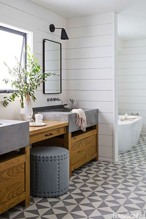 transitional bathroom with square concrete apron front sinks and wall mounted faucets