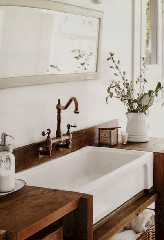 rustic bathroom with apron front farmhouse sink