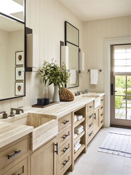 transitional bathroom with integrated apron front marble sinks in vanity