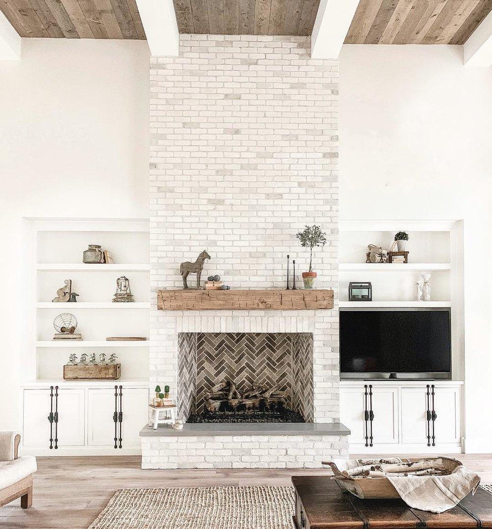 modern rustic farmhouse shaker cabinet black cremone bolt herringbone fireplace