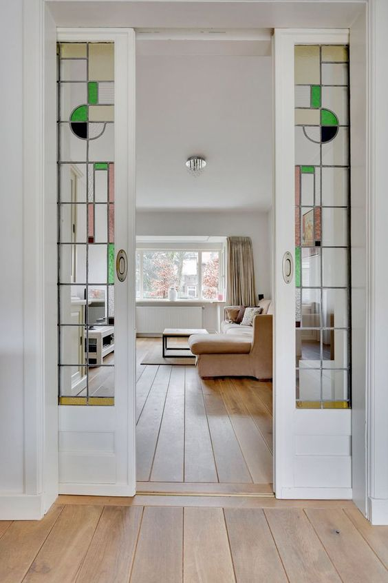 white french pocket doors with mid century stained glass leaded insert