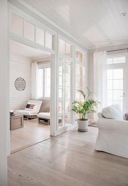 tri-fold white pocket door with grid mullion