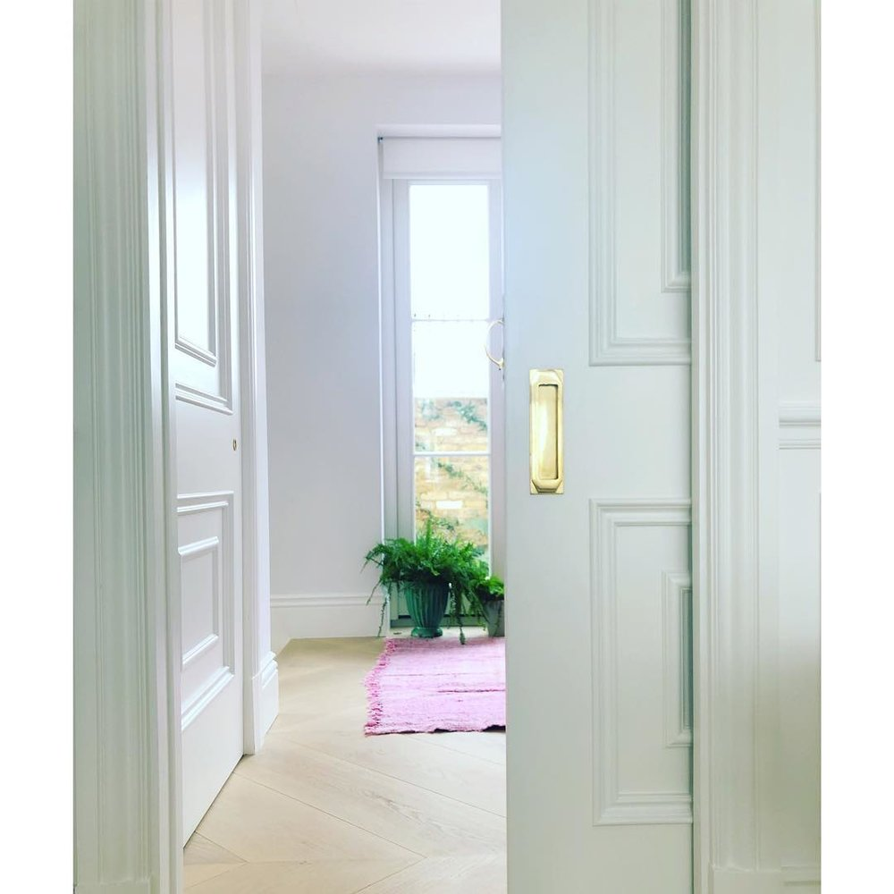traditional white moulding pocket door brass inset pull