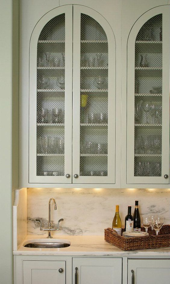 arched mint inset cabinet with wire mesh panel insert