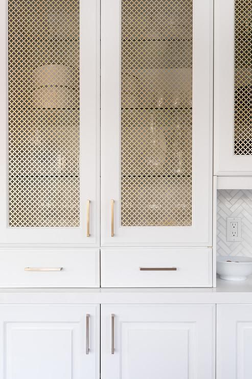 light cabinet with brass wire mesh panel insert