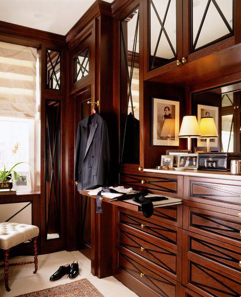 dark wood cabinet with mirror and decorative diamond mullion insert