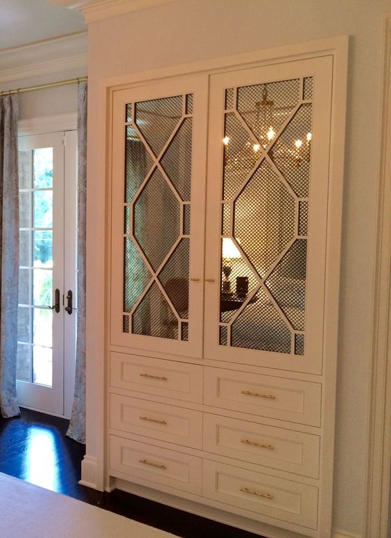 white cabinet with mirror and decorative mullion and wire mesh insert