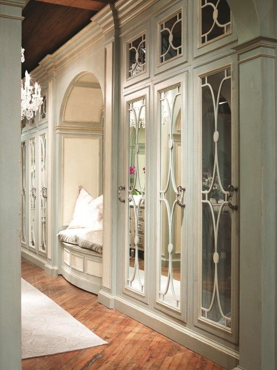 traditional cabinets with mirror and decorative mullions
