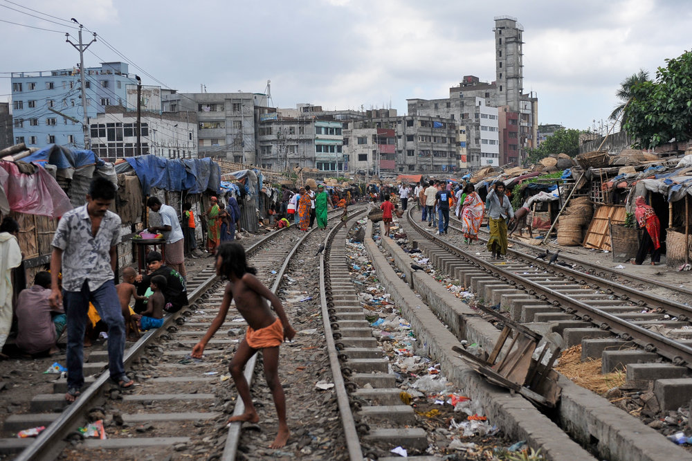 Homes beside the railroad tracks in Dhaka, Bangladesh. Dhaka is the capital of Bangladesh. It is one of the most populated cities in the world. Poverty reduction remains one of the challenges that Bangladesh confront. Photo Credit: Asian Development Bank under  Creative Commons 2.0 .