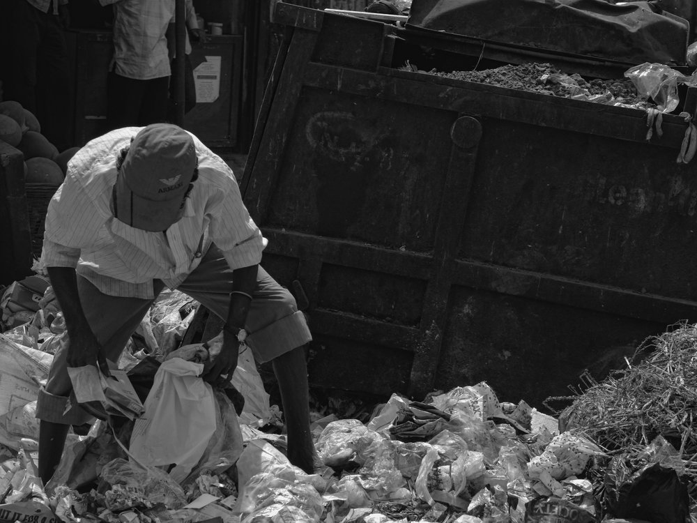 Rag Picker in India. Garbage seldom goes to waste in India. Rag-pickers sort through garbage and recover every last bit of useful material. Photo credit: Grant Eaton with Creative Commons  License 2.0 .