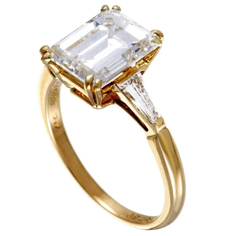 1stdibs Boucheron tapered baguette and emerald cut diamond yellow gold engagement ring