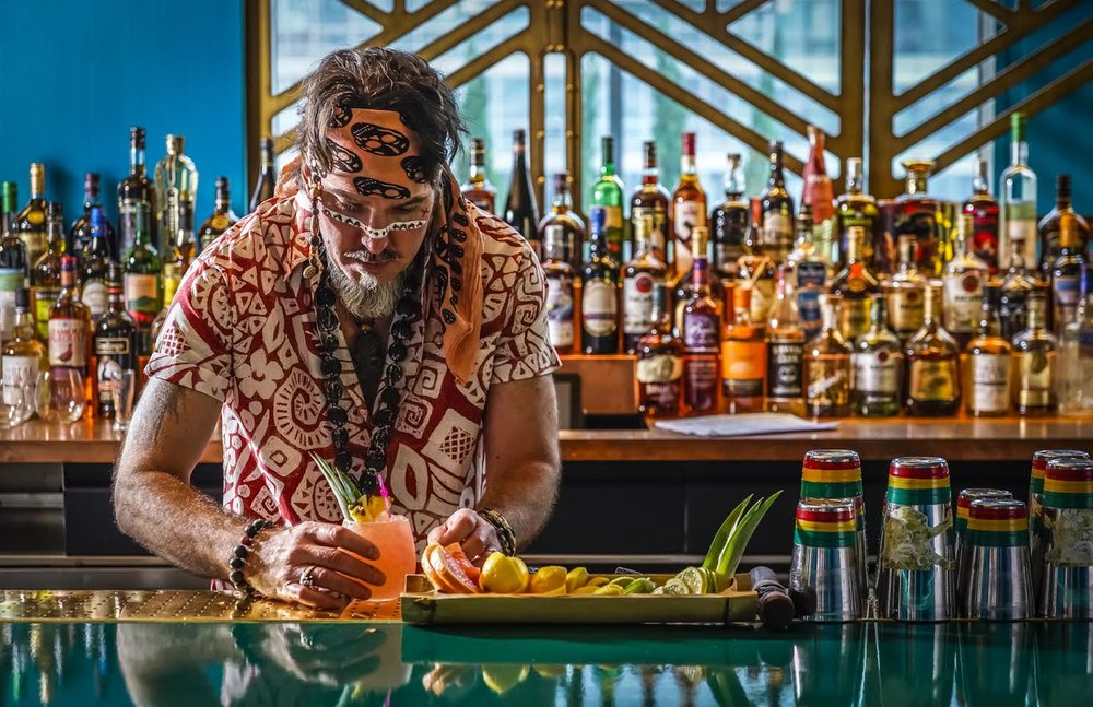 Captain, Brian Miller, preparing one of his delicious tiki cocktails