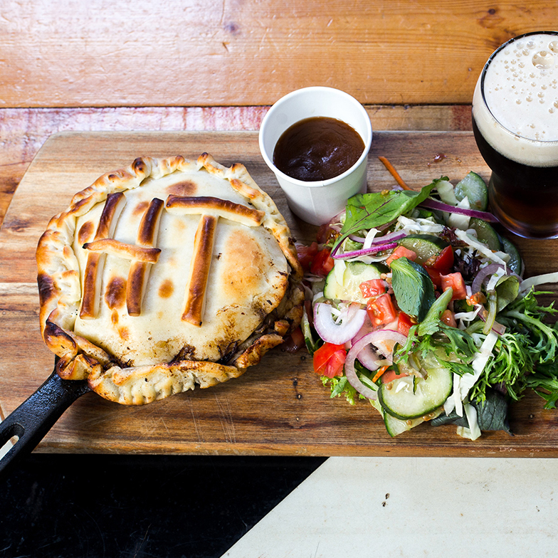 THE HOP TEMPLE -  CAVEMAN PIE  A signature beef rib pie, made with local beef by Sinclair Meats, Creswick Farm Eggs, Daylesford Butter & Red Duck Amber Ale, to compliment the deep taste of the beef whilst providing a caramel flavour through its malt bill.   BEER MATCH:   Red Duck Beer Amber Ale   Price:  $18 or $25 with beer  Gluten Free:  No  Where:  Hop Temple, rear of 24 Armstrong St, Ballarat