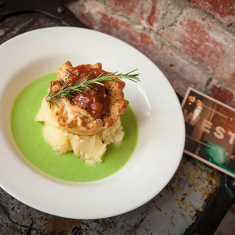 THE WESTERN HOTEL -  LAMB & ROSEMARY PIE  Slow cooked Waubra lamb on a bed of creamy mashed local potatoes with mushy peas.   BEER MATCH:   Cubby Haus Brewing Extra Special Bitter   Price:  $19 or $26 with beer  Gluten Free:  Gluten free pie available subject to availability, matched with O'Brien Pale Ale  Where:  The Western, 1221 Sturt St, Ballarat