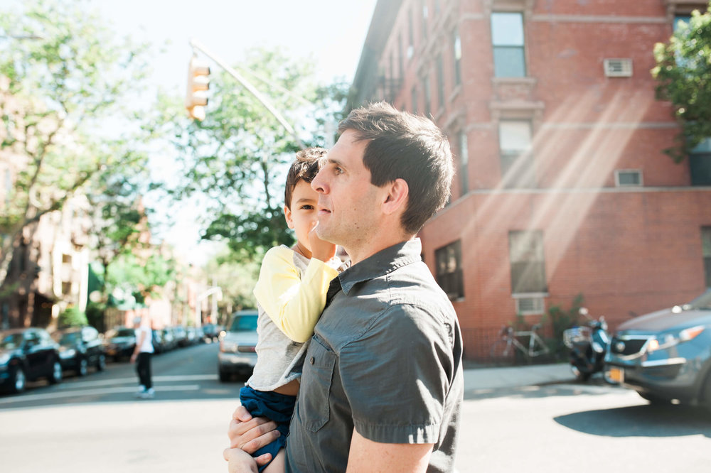 Father and son walking in Cobble Hill neighborhood Brooklyn New York family photographer lifestyle session in Cobble Hill by Lindsey Victoria Photography