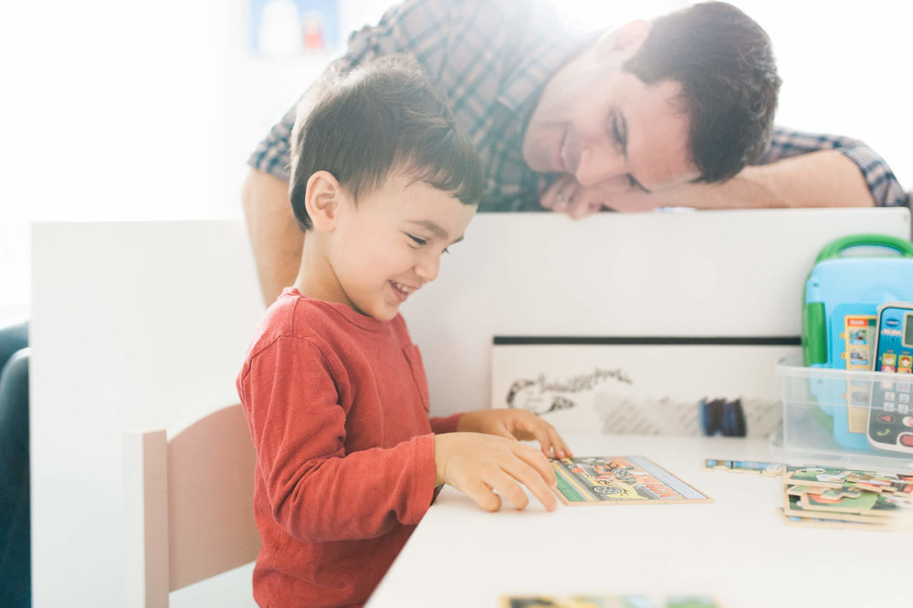 Father and son building a puzzle in the kid's room Brooklyn lifestyle family photographer based in Litchfield County, CT at home in Cobble Hill neighborhood by Lindsey Victoria Photography