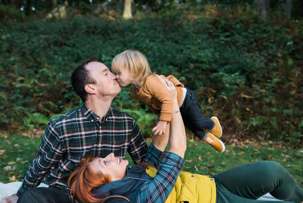 fall lifestyle family photo little girl kissing daddy in Washington CT photo by Lindsey Victoria Photography