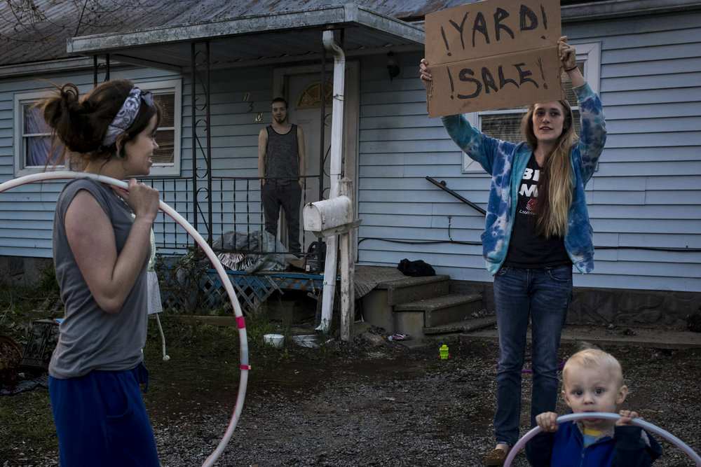 "Pleasant Ridge renters Tamara Taylor, 20, from left, and her boyfriend Dylan Hawkins, 20, look on as friend Shelby Jones tries to flag down yard sale customers while her son Aleki, 1, looks on. Taylor and Hawkins are just looking to clear out items and make some extra money with evictions in the neighborhood starting to take place. ""We've lived here for about a year,"" Taylor said. ""We can't find nowhere to move."" Taylor and Hawkins haven't heard a definitive eviction date yet, but some renters have to be out by March 31st. ""I don't see how half of these people are going to find somewhere to go,"" Taylor said. March 29, 2017"