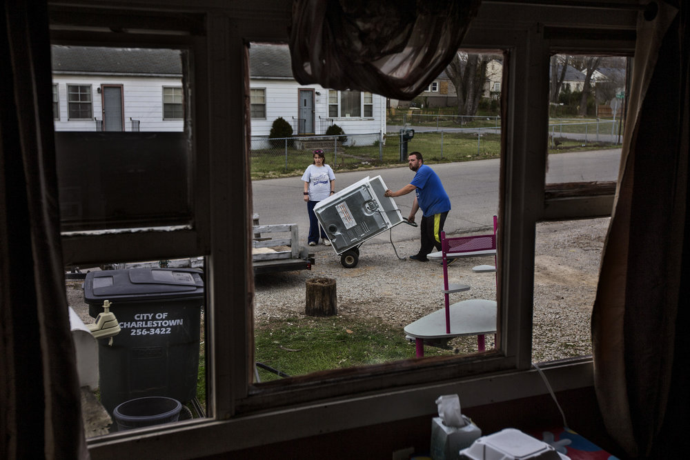 "Carla King, left, helps Michael Parrish load up a washer on to his trailer as he packs his family's belongings out of their Pleasant Ridge home. The family had to be out by March 31st, but is moving just a couple blocks away in the neighborhood where they've been told they can stay until the end of the year. ""You can't find nothing,"" Parrish said. He looked as far as Corydon in his searches. ""They all want three times the rent and you can't do that on a fixed income."" The family will be renting for $600-a-month at their new location, plus utilities, but only get $740-a-month from disability. March 24, 2017"