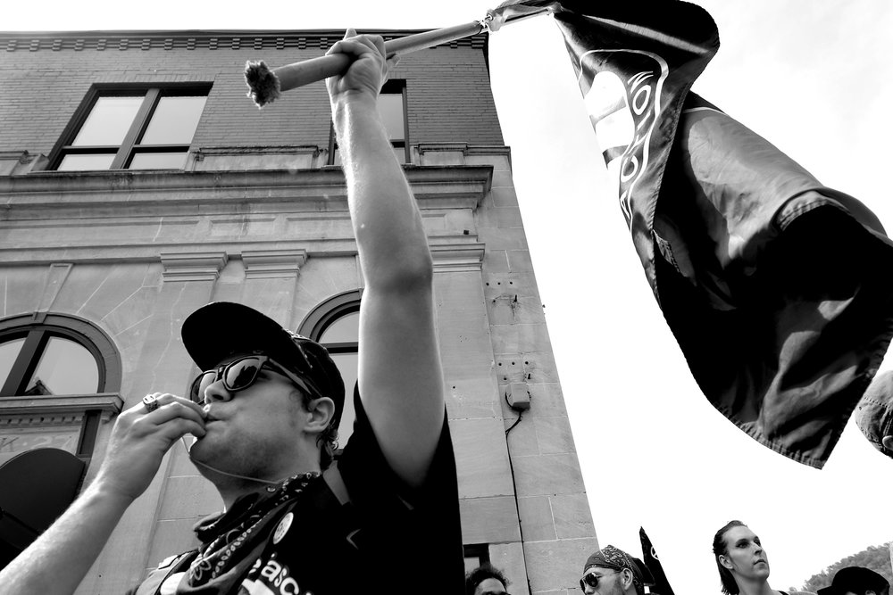 An anti-fascist member tries to use a whistle to shout down speakers at a white supracist rally Saturday, April 29, 2017, in Pikeville, Ky.